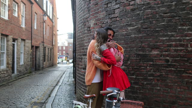 bohemian couple meeting in cobbled street - greeting stock videos & royalty-free footage