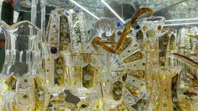 bohemian glassware on display in prague old town - kristalle stock-videos und b-roll-filmmaterial