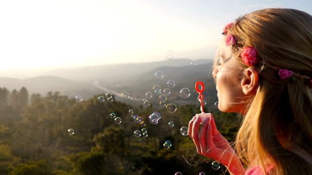 boho beautiful girl blowing bubbles - boho stock videos & royalty-free footage