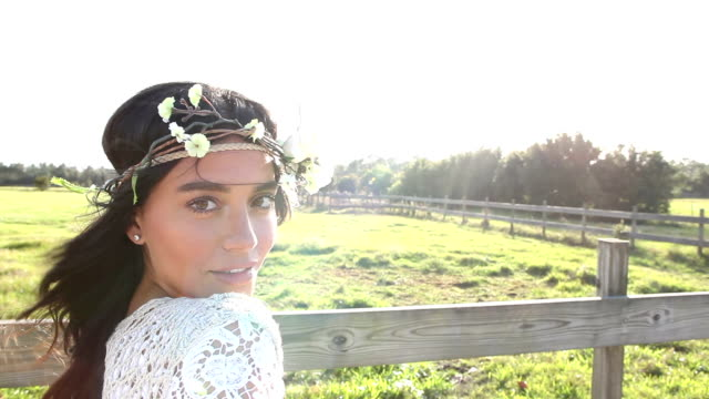 boho chic woman standing by wood fence and pasture - boho stock videos & royalty-free footage