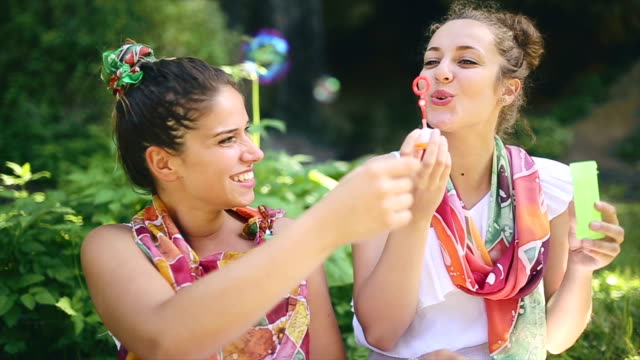 boho girls surrounded by nature in spring having fun - boho stock videos & royalty-free footage