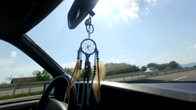boho style dream catcher in vintage car - rear view mirror stock videos and b-roll footage