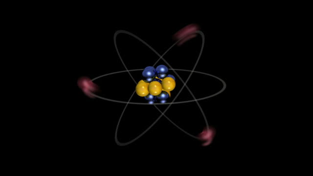 cgi of bohr model of an atom showing the electrons, neutrons and protons - 原子点の映像素材/bロール