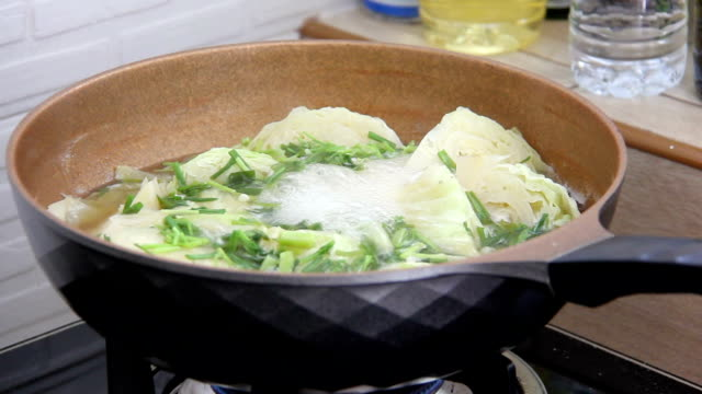 boil vegetable in pan on gas stove - stove stock videos & royalty-free footage