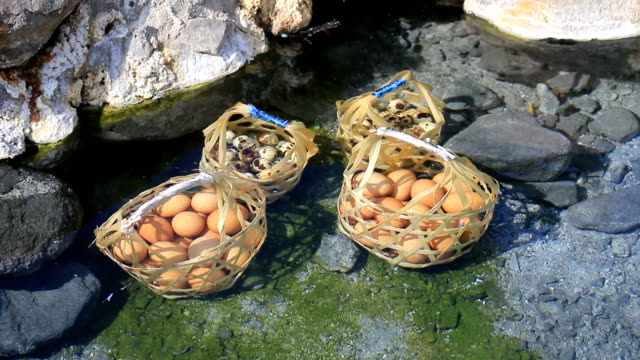 boiled eggs in hot spring. - oita prefecture stock videos & royalty-free footage