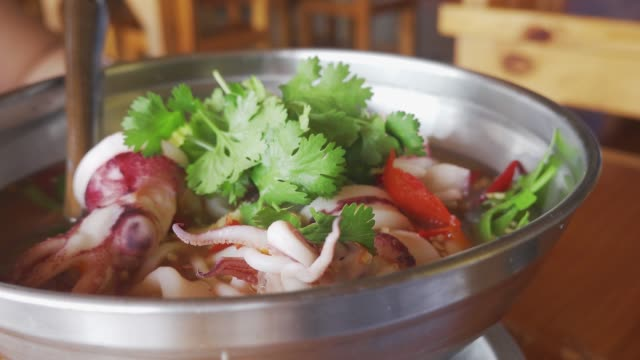 boiled squid with boiled lemon, sour and spicy taste similar to tom yum. thai food. - sour taste stock videos & royalty-free footage