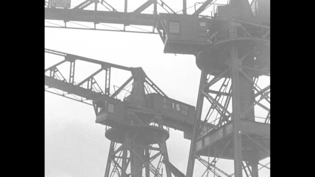 boiler being lowered into ship / tilt up crane that is lowering boiler / boiler being lowered into ship / men guiding boiler as it is lowered /... - boiler stock videos & royalty-free footage