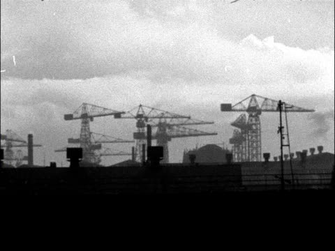 boilermakers strike at the cammell laird shipyards: general views shipyard; england: liverpool: ext various of cranes sitting idle in shipyard... - merseyside stock videos & royalty-free footage