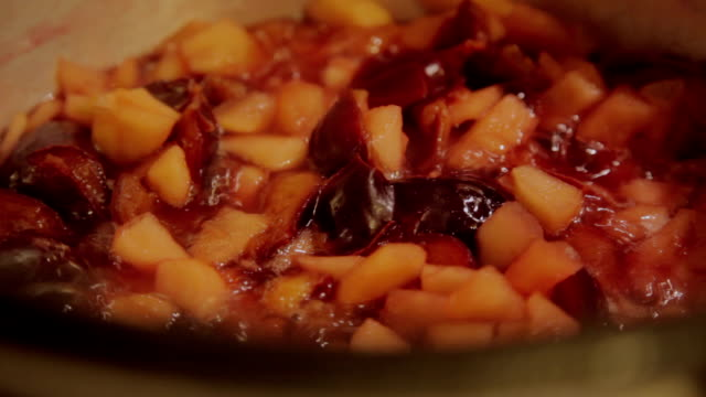 boiling apples and plums to make jam - home economics stock videos & royalty-free footage