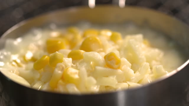 boiling cheese and corn in a pot - 野菜 とうもろこし点の映像素材/bロール