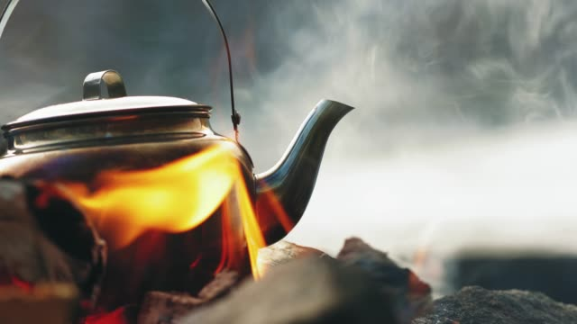 boiling coffee by the camp fire in winter - campfire stock videos & royalty-free footage