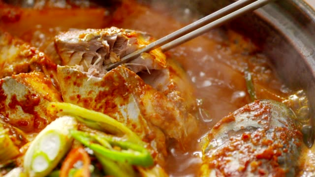 boiling godeungeo-jorim (braised mackerel) (popular main dish in korea) - braised stock videos and b-roll footage
