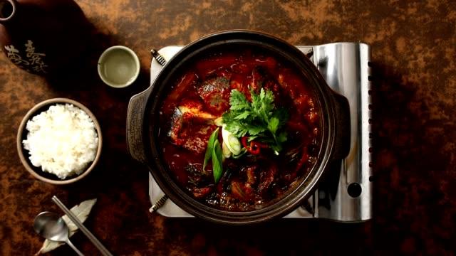 boiling godeungeo-jorim (braised mackerel) (popular main dish in korea) - preparing food stock videos & royalty-free footage