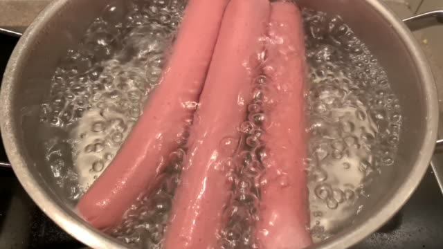 boiling hot dog in saucepan - simplicity stock videos & royalty-free footage