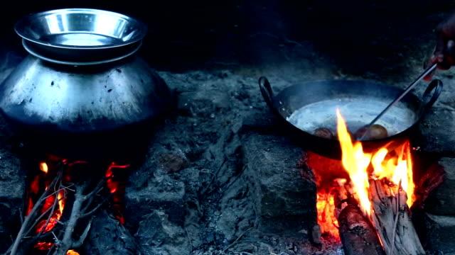 Boiling Potato on Wood Burning Stove using Bio fuel Energy.