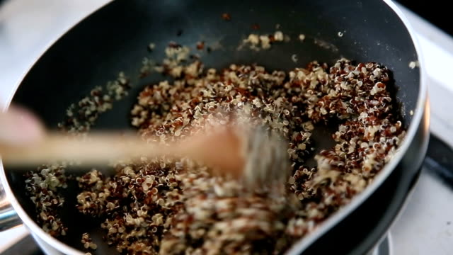 boiling quinoa in pot. - whole stock videos & royalty-free footage
