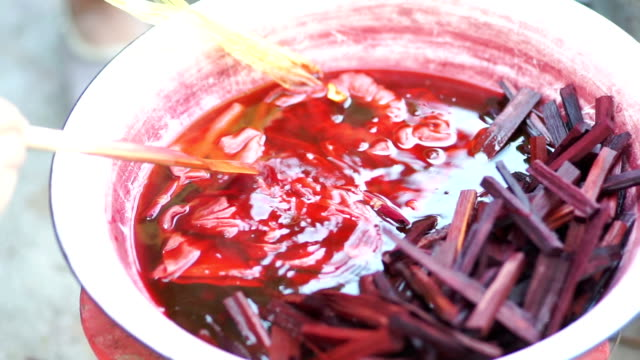 boiling red color nature for dyeing. - natural condition stock videos & royalty-free footage