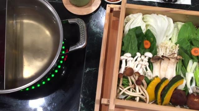 boiling sukiyaki hot pot vegetables - sukiyaki stock videos and b-roll footage
