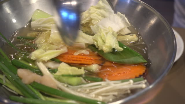 boiling vegetable on hot pot 4k footage