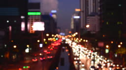 Bokeh abstract blurred background festive traffic yellow orange green red lights car on road sparkling circular animate motion 3D. Backdrop with twinkling bright shape blinking lights in modern city