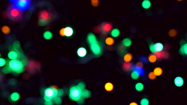bokeh christmas lights flashing is colourful. - public celebratory event stock videos & royalty-free footage