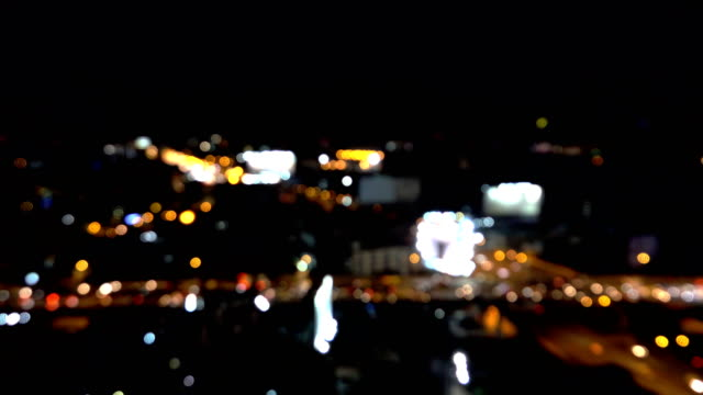 bokeh city traffic at night - cityscape stock videos & royalty-free footage