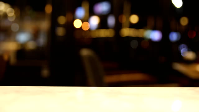 bokeh in bar at night background - restaurant stock videos & royalty-free footage