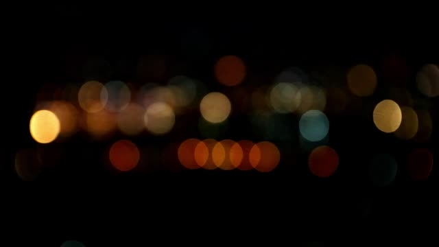 bokeh in dark blurry background at night, defocused night traffic lights, glassy circular shapes - 2013 stock videos & royalty-free footage