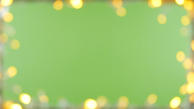 vídeos de stock e filmes b-roll de bokeh light frame green screen background - chroma key