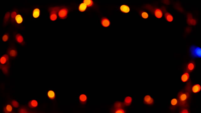 bokeh light frame multicolored black background - christmas lights stock videos & royalty-free footage