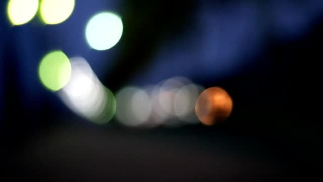 bokeh night at public park - dark stock videos & royalty-free footage