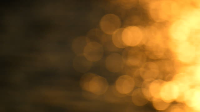 bokeh of sun reflected from sea - twilight stock videos & royalty-free footage