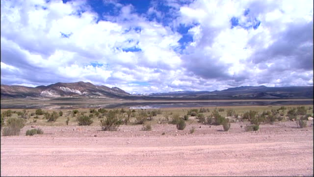 Bolivia is the site of large reserves of lithium likely to be main resource of future Salar De Uyuni EXT Car driven along plain General view of vast...