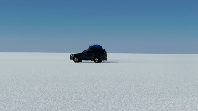 bolivia salts flats truck - infinity stock videos & royalty-free footage