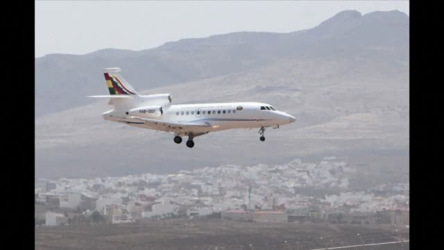 bolivian president evo moraless jet arrived wednesday at an airport in las palmas on spains canary islands on a technical stop after it was diverted... - grand canary stock videos and b-roll footage