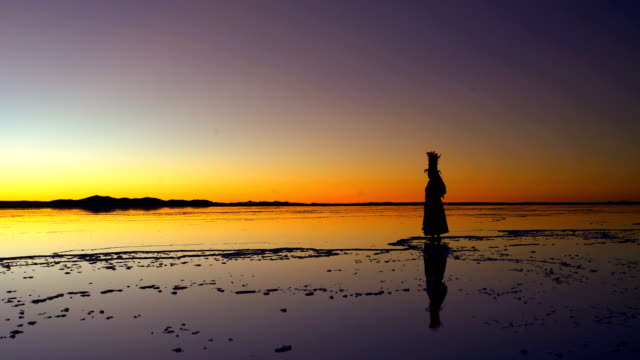 bolivian woman on salt flats in national clothing - bolivia stock videos & royalty-free footage