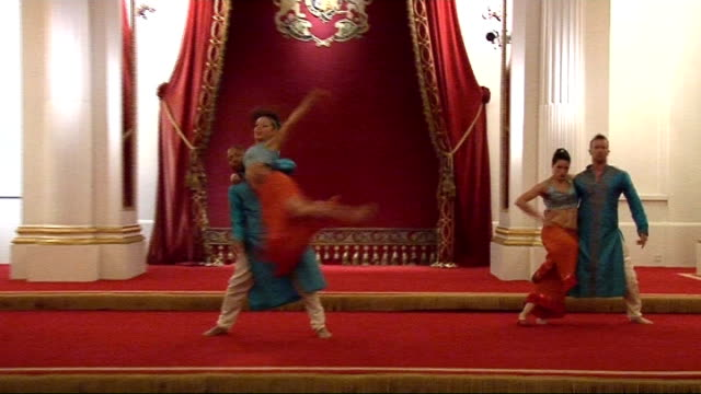 bollywood dancers rehearsing in ballroom - bollywood stock videos and b-roll footage