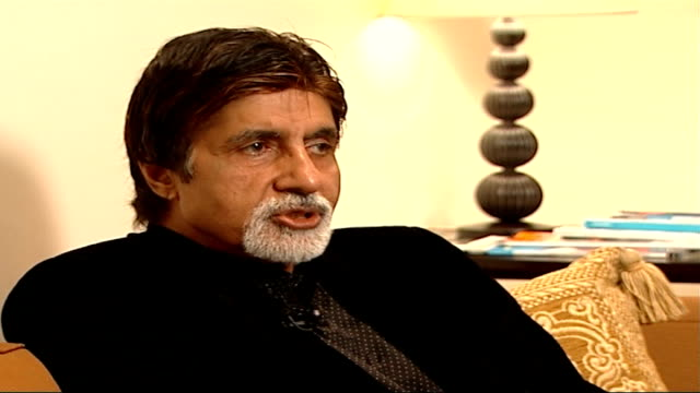 bollywood star amitabh bachchan interview england london int amitabh bachchan sot talks about making bollywood films / talks about the relationship... - interview stock videos & royalty-free footage