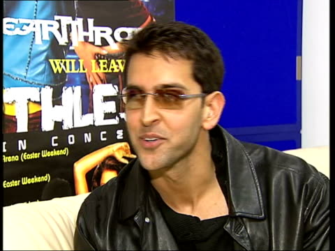 bollywood star hrithik roshan interview england london roshan roshan chatting to dj in radio studio roshan signing poster for photocall as press in... - bollywood stock videos and b-roll footage