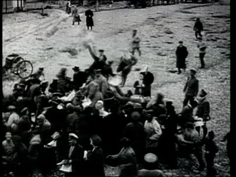 1918 b/w ha ws pan bolshevik militants throwing propaganda leaflets to people surrounding car on street during russian civil war/ russia - 1918 stock videos & royalty-free footage