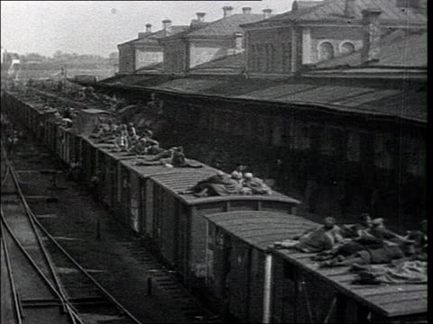 bolshevik recruits are sent to the front. men lining up in front of building, man lighting cigarette, soldiers on roof of a train leaving the station... - 1918 stock videos & royalty-free footage