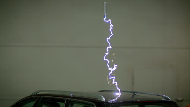 "bolt of electricity hitting a car in a lab - ""bbc universal"" stock-videos und b-roll-filmmaterial"