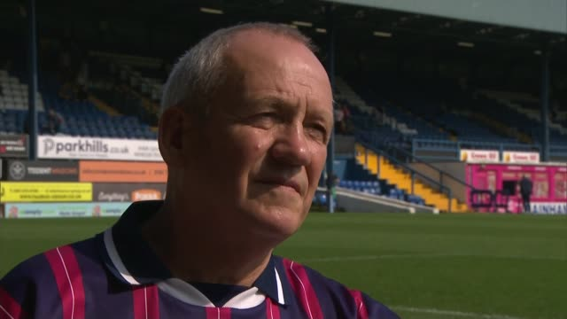 bolton and bury face expulsion from english football league uk bury and bolton football fans cleaning gigg lane ground vox pops dave giffard... - bolton greater manchester stock videos and b-roll footage