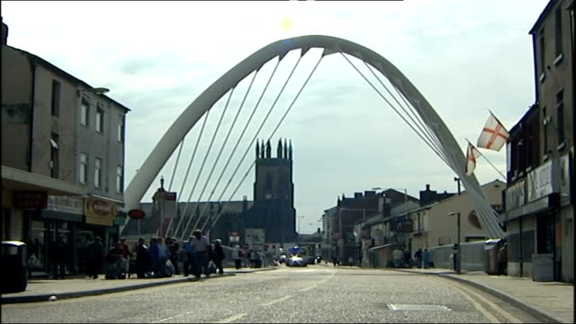 general views england greater manchester bolton ext modern looking suspension bridge as pedestrians and traffic along - bolton greater manchester stock videos and b-roll footage