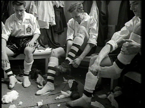 Bolton players changing into strips and boots in dressing room including captain Willie Moir pulling on his number 8 shirt Blackpool FC vs Bolton...