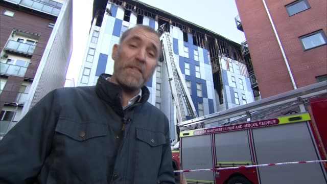 bolton university accommodation fire: concerns raised over continued use of flammable cladding; england: greater manchester: bolton: ext reporter to... - flammable stock videos & royalty-free footage