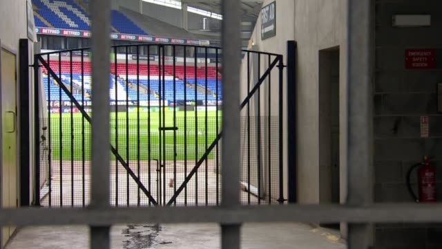 stockvideo's en b-roll-footage met bolton wanderers remain on strike over unpaid wages; england: greater manchester: bolton: university of bolton stadium : ext tilt up locked stadium... - itv weekend evening news