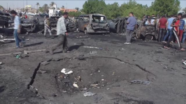 Bomb attacks killed 19 people in Baghdad on Wednesday as US Secretary of State John Kerry visited the Iraqi capital for talks on combatting jihadists...