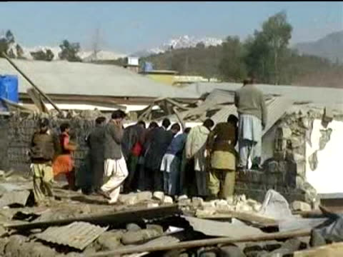 bomb blast in pakistan claimed by the taliban killed eight people wednesday, including three us soldiers and children at the opening of a school just... - peshawar stock videos & royalty-free footage