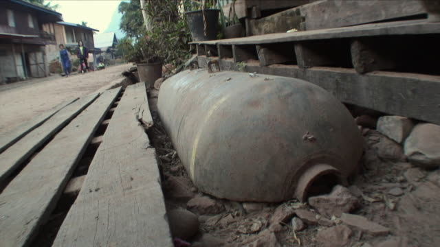 cu bomb casing used as step / muang ngoi neua, laos - laos stock videos and b-roll footage